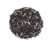 De zwarte die thee van Ceylon met citroengras en korenbloembloemblaadjes op een witte achtergrond worden geïsoleerd Hoogste menin royalty-vrije stock fotografie