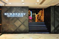 De zwarte en blauwe boutique van Burberry, Hongkong Stock Afbeeldingen