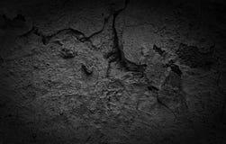 De zwarte Gebarsten concrete achtergrond van de textuurclose-up Royalty-vrije Stock Afbeelding