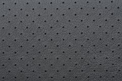 De zwarte Geperforeerde Textuur van het Leer of van de Huid Royalty-vrije Stock Foto's