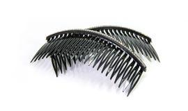 De zwarte haarkam verfraait diamant op witte achtergrond Royalty-vrije Stock Fotografie