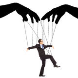 De zwarte handenschaduw controleert een zakenmanactie Royalty-vrije Stock Fotografie