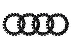 De zwarte plastic scrunchy lente vier Royalty-vrije Stock Afbeeldingen