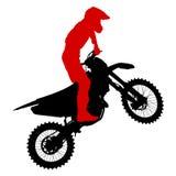 De zwarte ruiter van de silhouettenmotocross op een motorfiets Stock Afbeeldingen