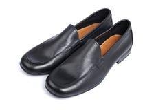 De zwarte schoenen van de mens stock foto's