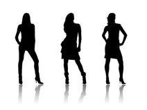 De zwarte silhouetten van vrouwen Royalty-vrije Stock Afbeeldingen