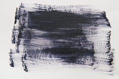 De zwarte slag van de waterverfborstel over witte achtergrond royalty-vrije stock afbeeldingen