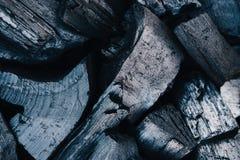 De zwarte steenkolen sluiten omhoog achtergrond stock fotografie