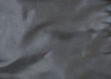 De zwarte synthetische textuur van de stoffenzak Stock Foto