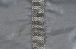 De zwarte synthetische textuur van de stoffenzak Stock Afbeelding