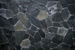 De zwarte textuur van het steenpatroon Stock Foto's
