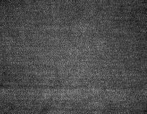 De zwarte de textuurachtergrond van denimjeans kan als behang horizontale richtlijn worden gebruikt stock foto's
