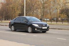 De zwarte Toyota Corolla-auto royalty-vrije stock foto