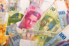 de Zwitserse bankbiljetten van 100, 50, 20, en 10 CHF Stock Foto's