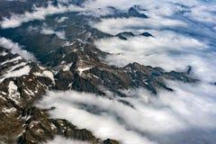 De Zwitserse luchtmening van alpen van vliegtuig Stock Foto's