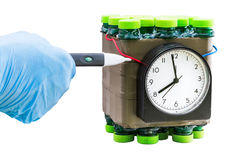 Deactivation found timed bomb. Deactivation of dangerous timed bomb on white background. Isolated Stock Photography