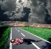 Dead. Young woman dead on the road Royalty Free Stock Photos