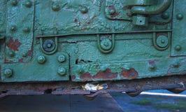 Dead bird under the caterpillar of tank Stock Photo