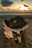 Dead boat on the beach Stock Images