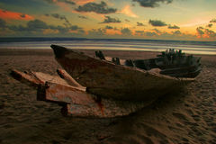 Dead boat on the beach Stock Photography