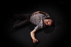 Dead body lying on floor. Dead body lying on a floor in the dark Royalty Free Stock Image