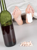 Dead body with toe tag. Suicide by drug overdose and alcohol Royalty Free Stock Photos