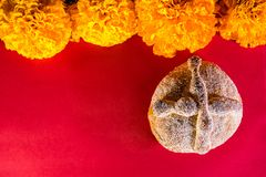 Dead bread and mexican marigold flower - Day of the dead celebration. Day of the dead celebration - pan de muerto Royalty Free Stock Photo