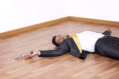 Dead businessman in the floor Royalty Free Stock Photos