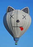 Dead Cat Hot Air Balloon. I suppose that even is a sport like hot air ballooning, a sense of humor is required.  Here, a dead cat hot air balloon rises Royalty Free Stock Photography