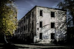 Dead city in Russia abandoned house yard. Apocalypse of a dead city in Russia abandoned house yard in autumn stock images