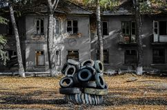 Dead city in Russia abandoned house yard. Dead city apocalypse in Russia abandoned house courtyard in the autumn royalty free stock image