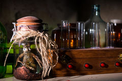 Dead creature with bulging eyes inside jar sealed with string be Stock Image