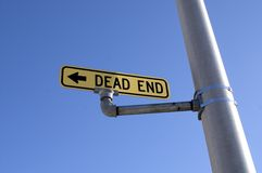 Dead End Sign Light Post Blue Sky Transportation. Street Sign indicating Dead End with blue sky and cloud background Stock Image