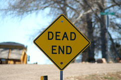 Dead end. Bold picture of a dead end sign with blurred images in the background stock image
