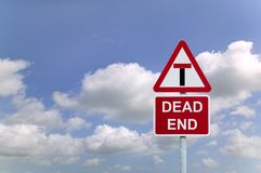 Dead End. Concept image of a signpost for a Dead End againsta blue cloudy sky royalty free stock image