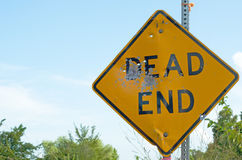 Dead end with bullet holes. Dead end -sign with bullet holes indicating deadly end royalty free stock photos