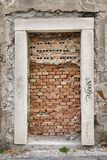 Dead End Doorway. A doorway on an building in the Old Town area of Bratislava, Slovakia is briicked up to form a closed, dead-end entrance. A symbolic metaphor Royalty Free Stock Photos