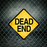 Dead End Grunge Yellow Warning Sign on Chainlink Fence Royalty Free Stock Image