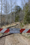 Dead end - road closed. Forest road closed to protect wildlife - white and red gate with a sign, Rocky Mountains, Colorado Stock Images