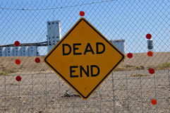 Dead End Sign 2. Dead End Sign at End of Levee Canal with Storage Containers in Background Royalty Free Stock Images