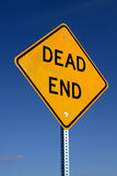 Dead End Sign. A dead end sign against a blue sky stock photo