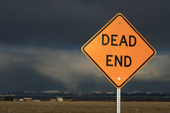 Dead End Sign. With ominous clouds in the distance stock image
