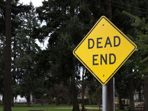 Dead End Sign. A mounted Dead End sign with a park in the background Stock Images