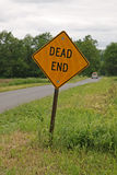 Dead End Sign. On edge of country road with pick-up truck in background Royalty Free Stock Image