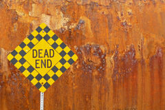 Dead end sign with rusted train car background Royalty Free Stock Photos