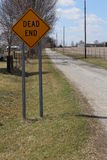 Dead end sign on a straight country road Royalty Free Stock Photography