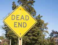 Dead End sign with trees in th background Stock Images