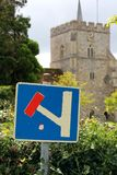 Dead End Signpost in front of a church Royalty Free Stock Image