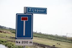 Dead end street sign with name of street `zijspoor ` in dutch which means in english `sidetrack `.  stock image