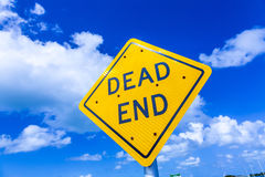 Dead end street sign under blue sky Stock Images